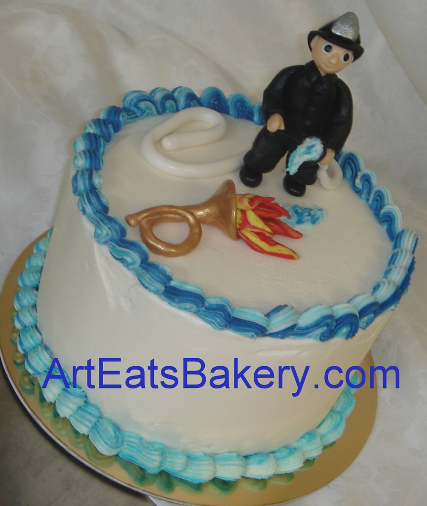Custom butter cream birthday cake with fondant fireman, ho ...