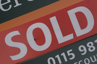 red sold sign | by Diana Parkhouse