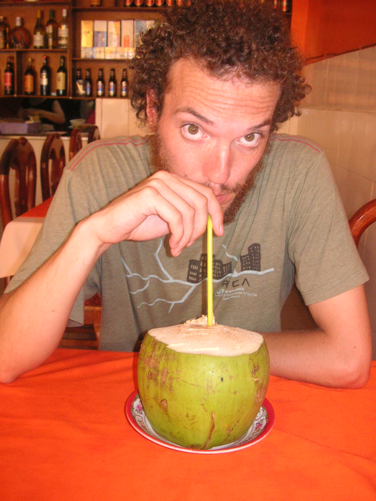 Drinking straight out of a coconut