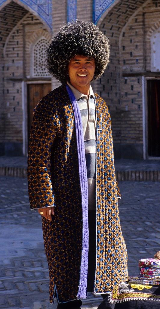 Uzbekistan Khiva Man In Padded Chapan And Woollen Telpek