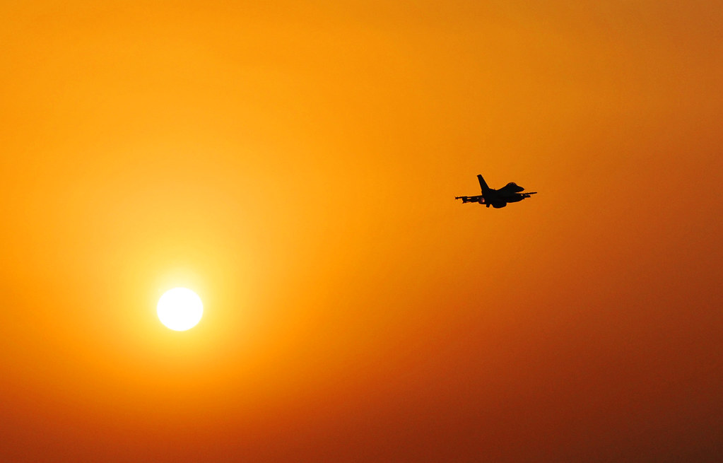 Airplane flying into the sunset