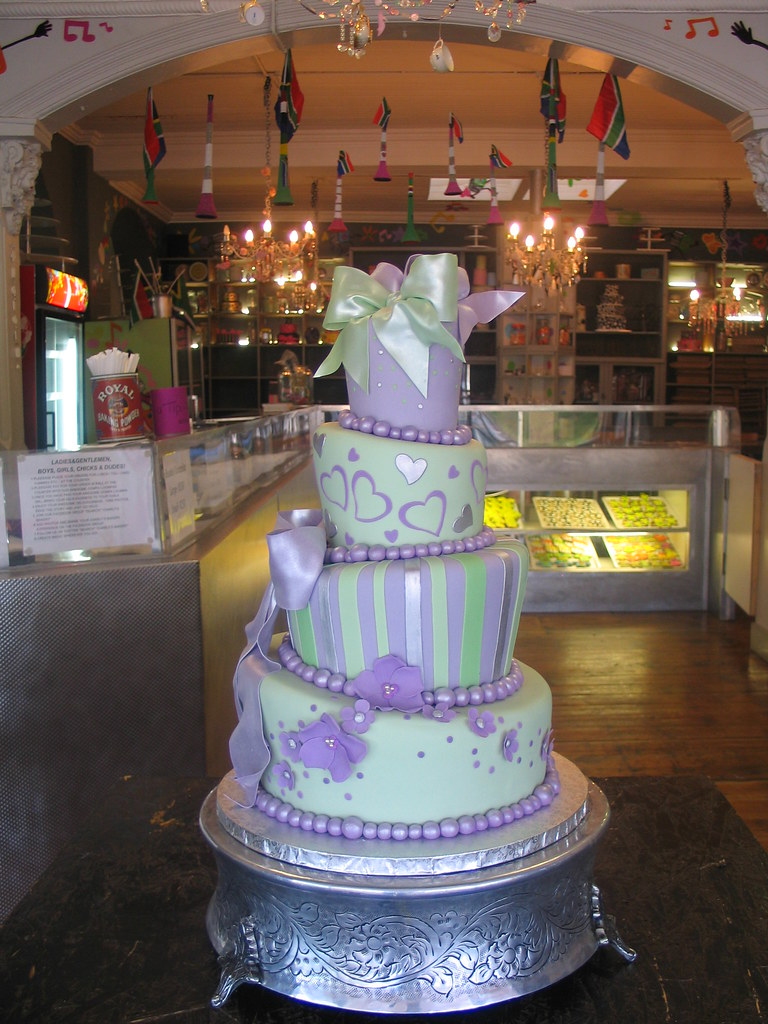 4 tier mad hatter wedding cake in sage green & lilac | Flickr