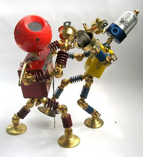 off his feet - Found Object Robot Assemblage Sculpture Action Figures By Brian Marshall | by adopt-a-bot