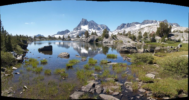 The Minarets, Banner Peak, Mount Ritter and Mount Davis reflected in a small pond on Island Pass