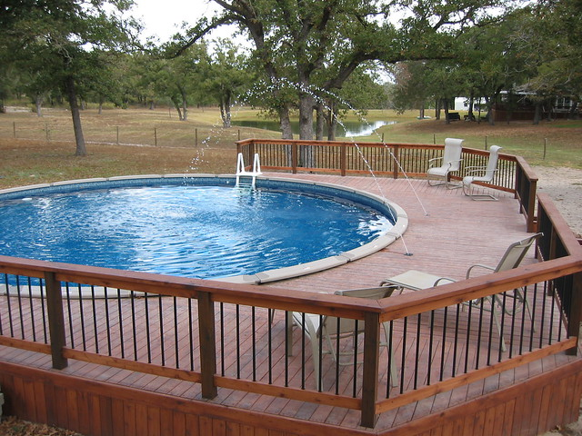 Above ground pool deck jets and dark blue liner lavernia for Above ground pool decks for small yards