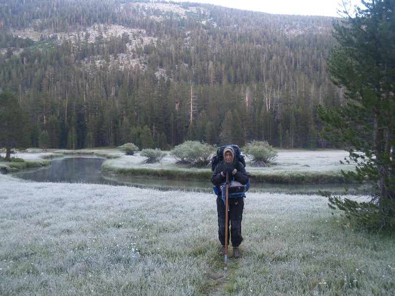 Vicki has on plenty of layers as she stands in the frosty meadow, ready to start hiking