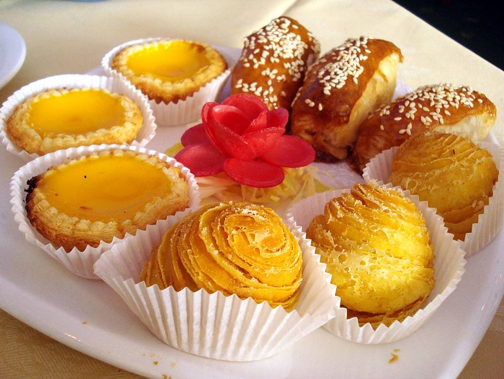 Egg tarts, deep fried turnip puff pastry (蘿蔔絲酥餅), and cris ...