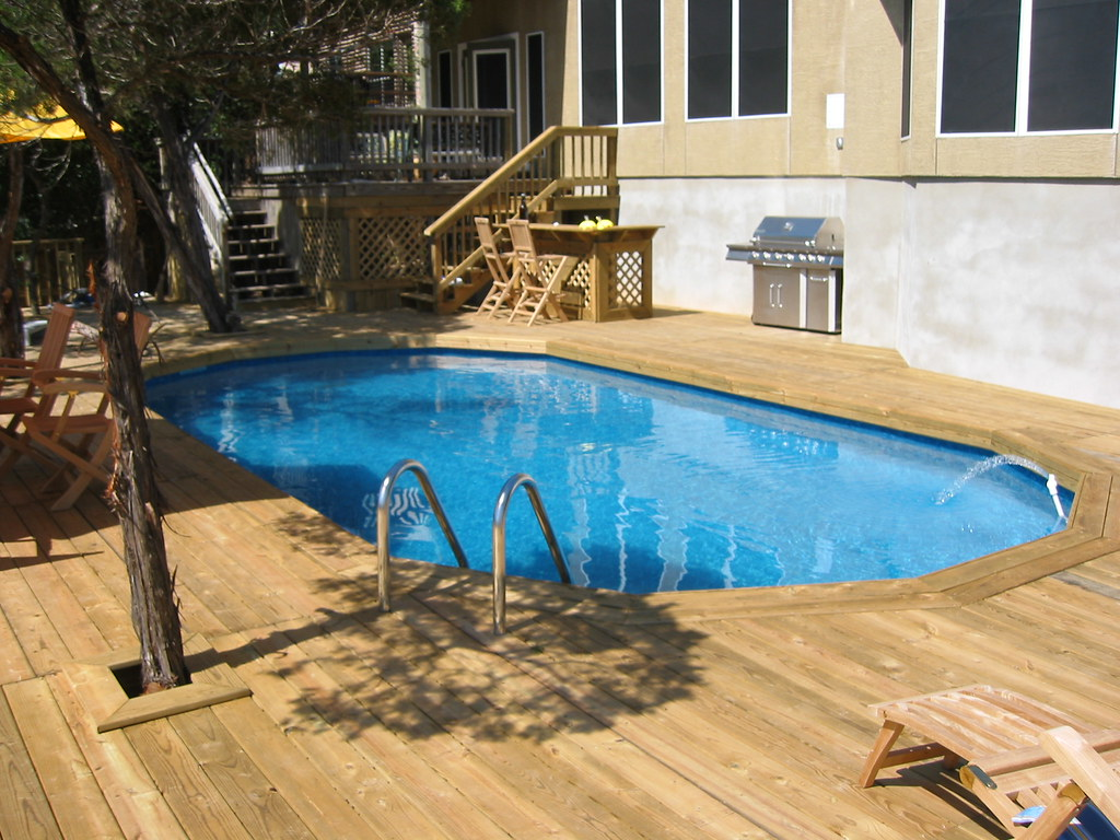 Decked oval above ground pool san antonio tx throw a for Oval swimming pool