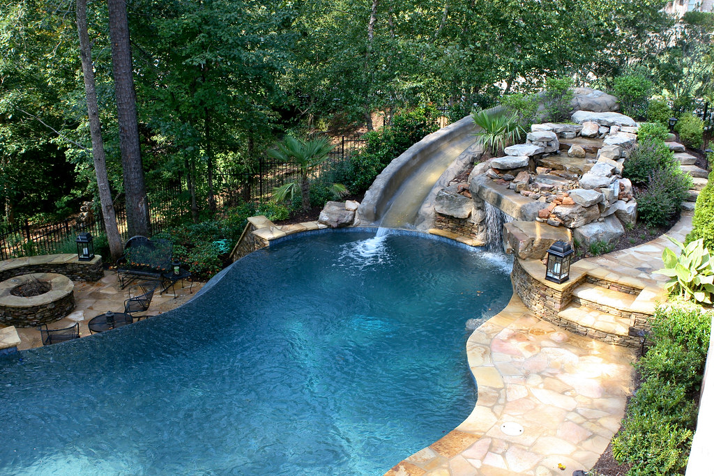 Pool with slide waterfall grotto cave vance dover flickr for Big garden pools