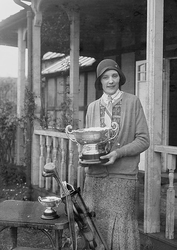 Lady holding the Llandrindod Wells Open Challenge Bowl outside Llandrindod Wells Golf Club pavilion | by LlGC ~ NLW
