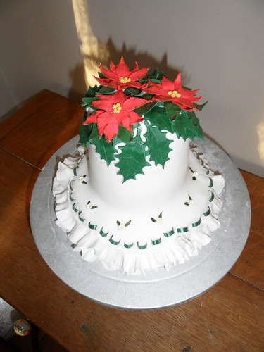 Bell Shaped Christmas Cake With Pointsetta Flowers And Hol