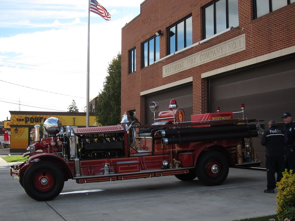 Vintage Ahrens Fox Fire Truck In Front Of The Fire House
