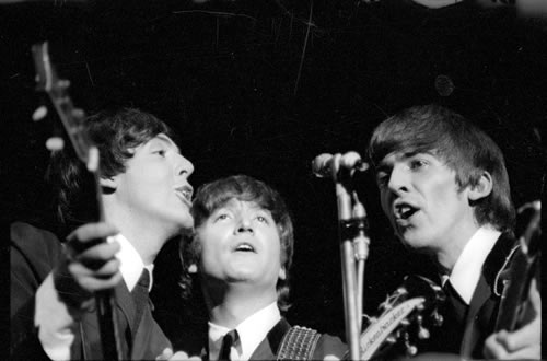 Paul McCartney, John Lennon and George Harrison perform at one of The ...