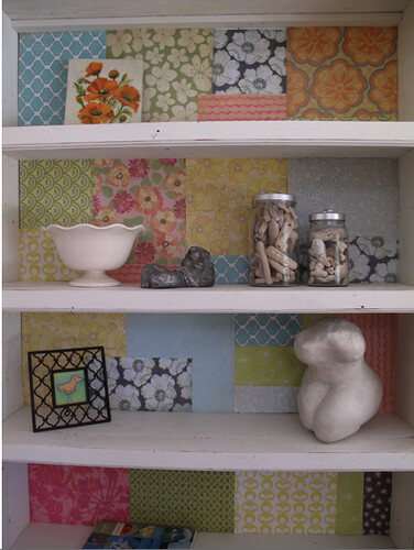 Patchwork-lined bookshelf | by Hidden In France