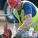 Pipefitter prepares a pipe threader at the Warrior Transition Unit