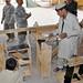 Airmen help Afghan boys build shelves