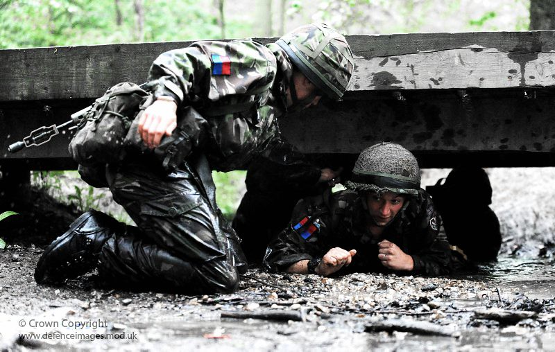Soldiers Negotiate Army Assault Course