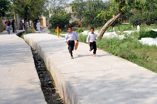 Children run along new roads | by United Nations Development Programme