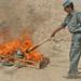 Afghan police burn heroin