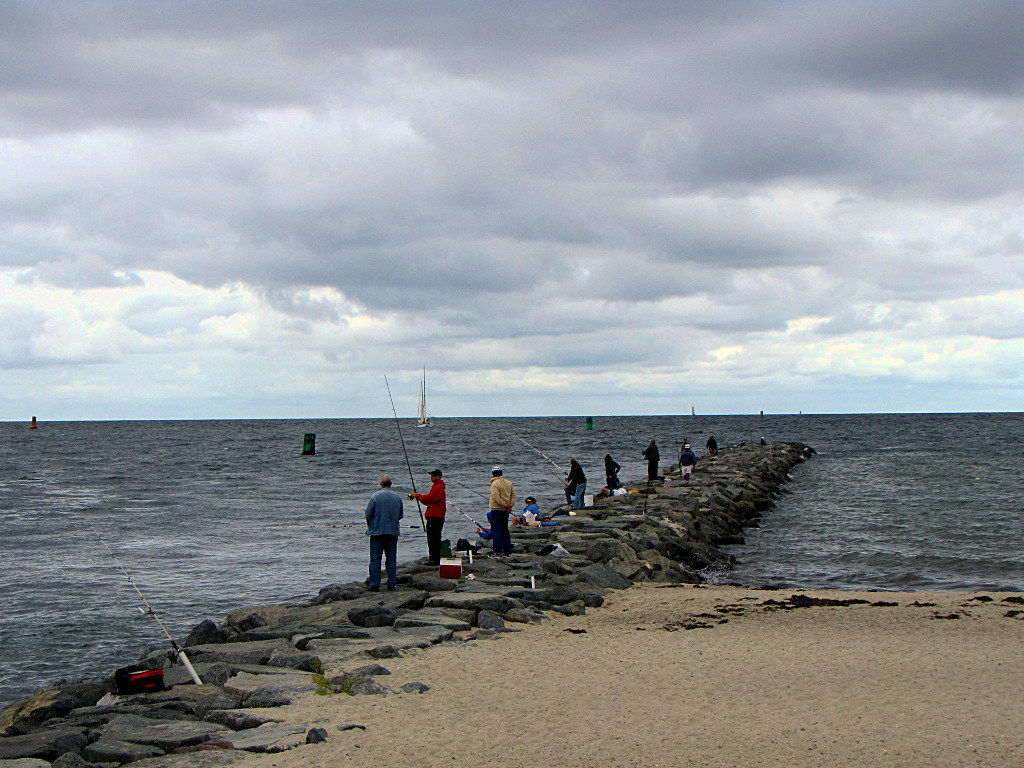 Cape cod canal fishing fishermen on the jetty at the for Cape cod fishing