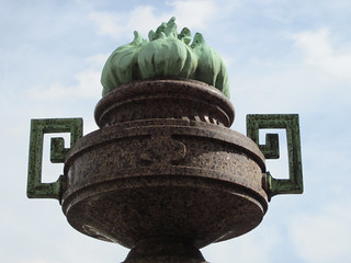 Stone urn with verdigris metal flame | by Monceau