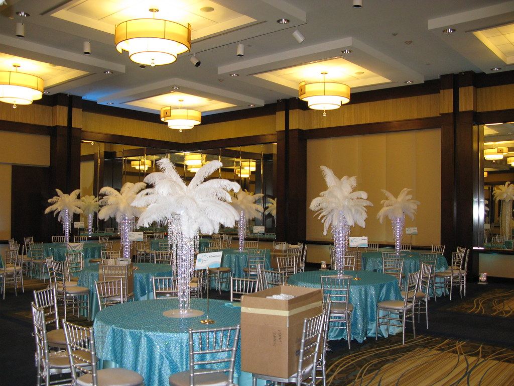 Acrylic Chandelier Centerpieces With Led Lights And White Ostrich Feather Top By The Prop Factory