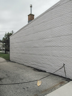 The chain's out dripping its rust-water in Sheboygan but what I notice more is the large wall. | by Tim Kiser