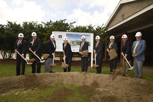 Dr. Leath and others shovel dirt at a groundbreaking on the Gulf Coast.