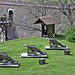 Three medieval cannons o green lawn next to watchpost