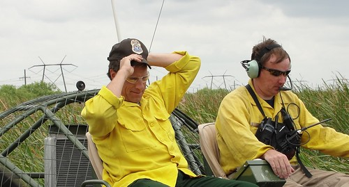 Hang on to your hat mike rowe holds on to his cap as jon for Us fish and wildlife service jobs