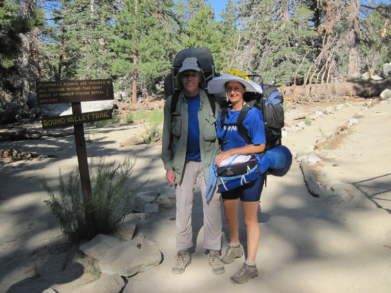 Vicki and I with our backpacks at the beginning of the Round Valley Trail, not far from the Ranger Station