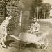 Girl Pushing Herself in a Wheelbarrow