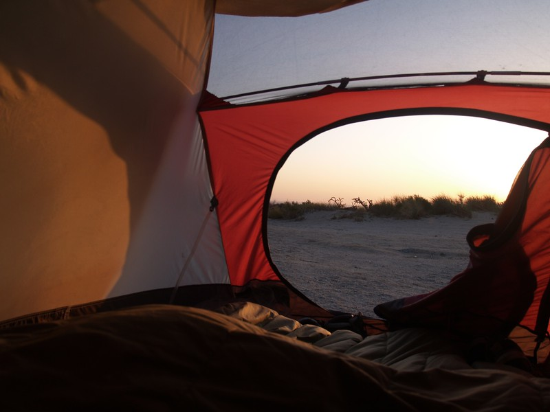 Looking out of our tent door at the crack of dawn. Time to get hiking!