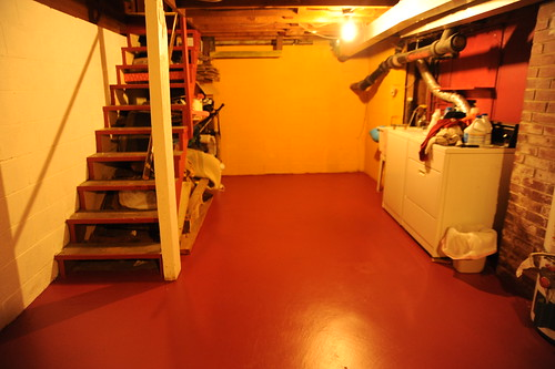 freshly painted basement floor clean clothes rafters brick chimney