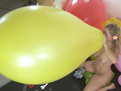 Nude girls blow and pop balloons