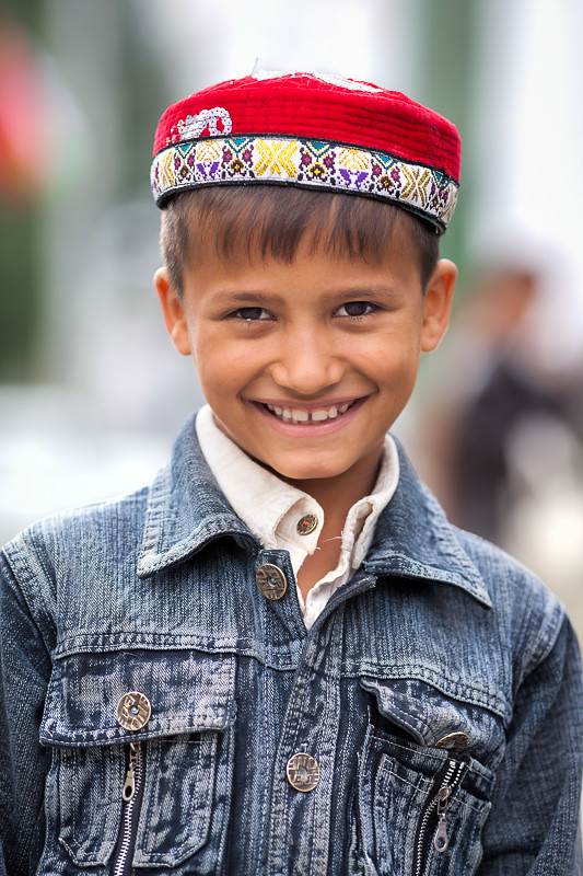 happy pamiri boy with traditional red hat a happy
