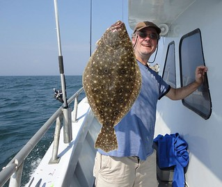 Richard Gunion holds up a beautiful flounder
