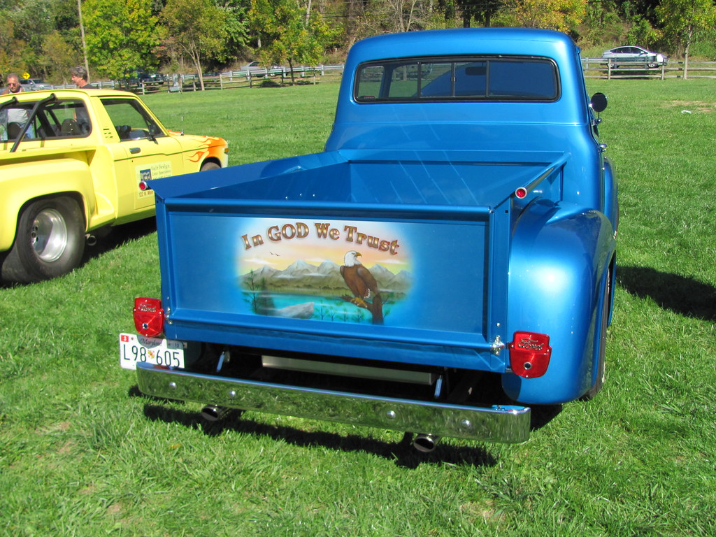 """""""IN GOD WE TRUST"""" DECAL ON OLD BLUE FORD TRUCK 