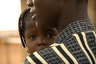 Holding a child | by World Bank Photo Collection