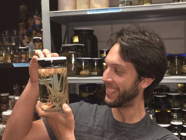 Kenneth Halanych holds a jar with an invertebrate.