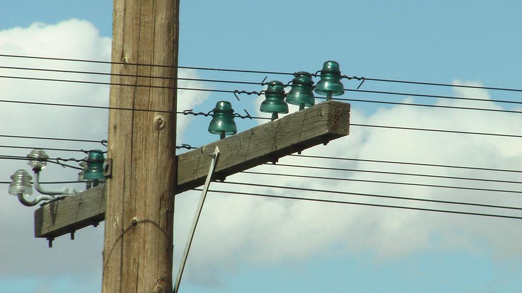 Glass insulators on telephone pole beebot flickr for Glass telephone pole insulators