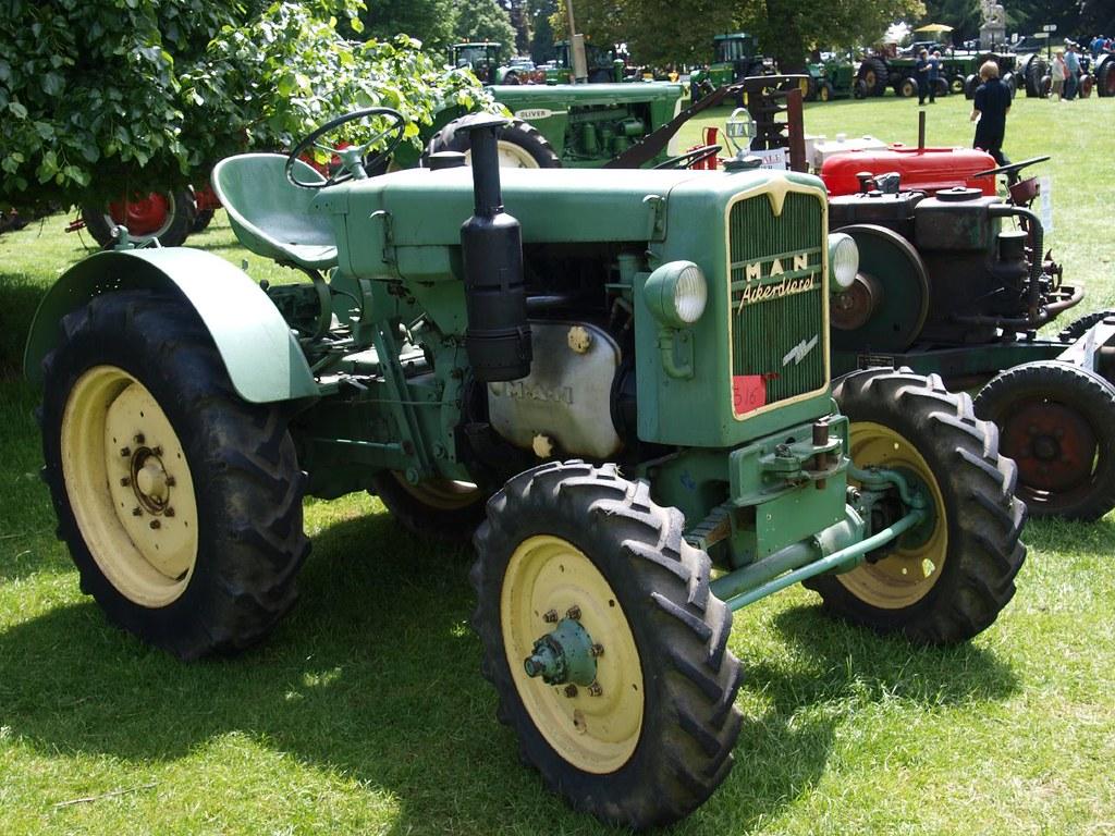 Guy On Tractor : Man acker diesel farm tractors