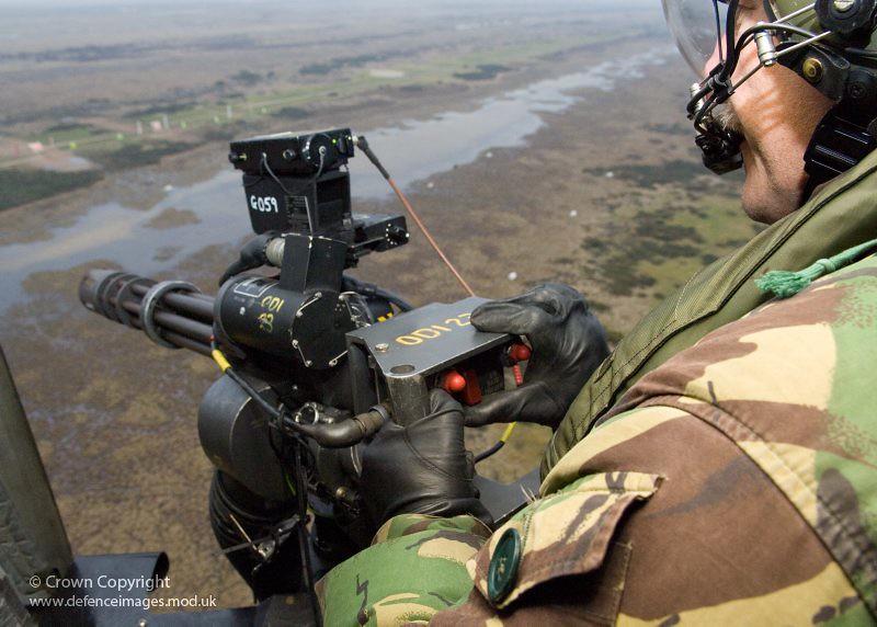 a door gunner mans a m134 six barrelled 762mm minigun onb