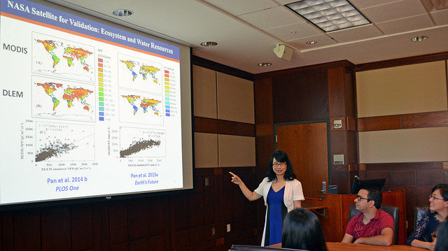 Susan Pan teaches students about geospatial and environmental informatics in a conference room.