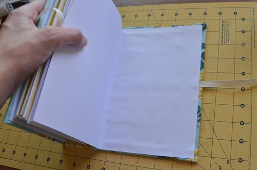 33. Press out bubbles in cardstock endpaper as best you can.