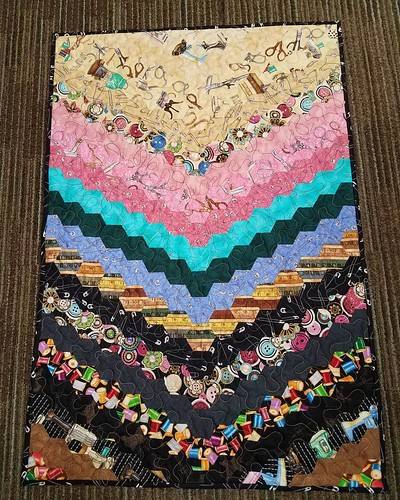 Finished my oldest UFO, started in June 2011. A hand sewn, English Paper Pieced table runner.