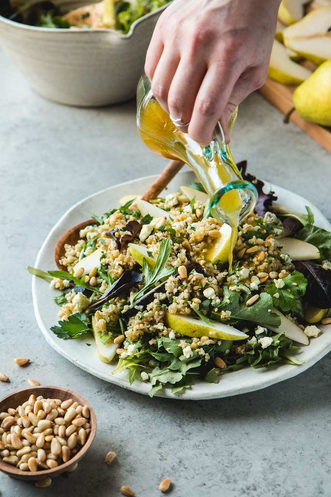 Warm Freekeh Salad With Pears, Gorgonzola, Toasted Pine Nuts, and White Balsamic Vinaigrette