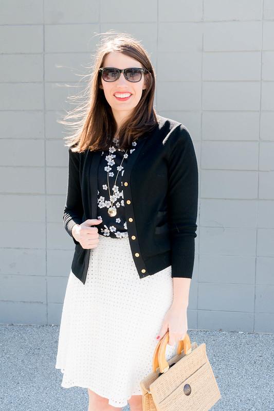 white eyelet skirt + black floral tee + black J.Crew cardigan + wicker straw bag + Target black heel sandals | Style On Target blog