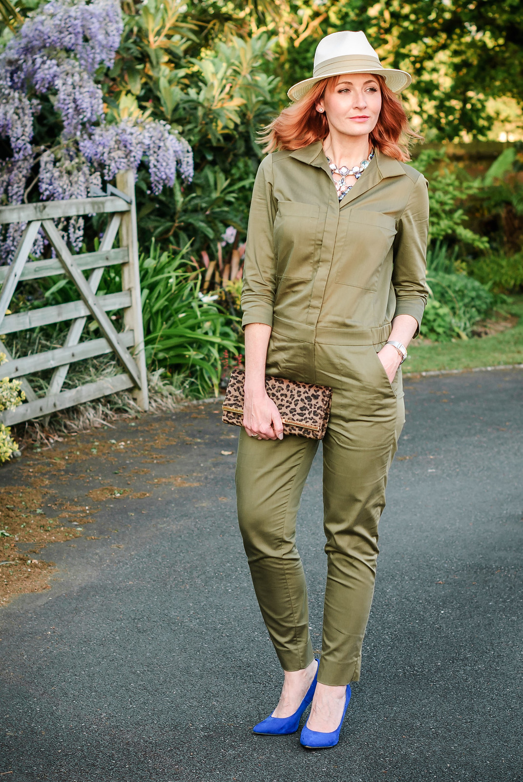 What to wear with a safari-style khaki jumpsuit: Cream fedora  statement crystal necklace  cobalt blue heels  leopard clutch | Not Dressed As Lamb, over 40 style