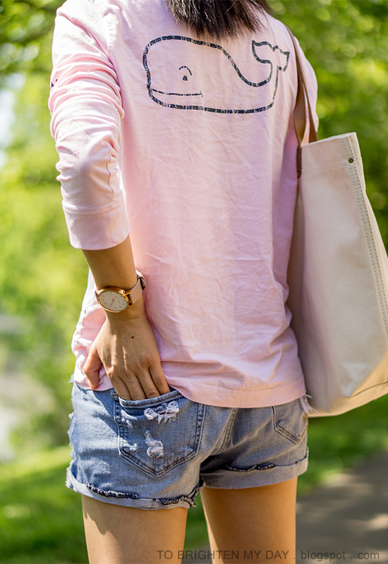 pink graphic tee, oversized watch, canvas tote, distressed shorts